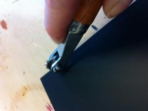 pricking the stitch holes...